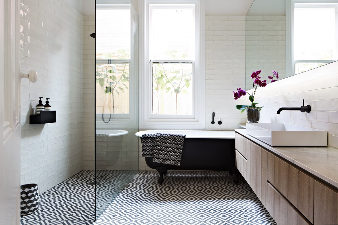 Diamonds are forever in this graphic [black & white bathroom](http://www.homestolove.com.au/a-tile-inspired-bathroom-design-2410) where statement tiles are off-set by bespoke white subway tiles on the wall. *Photo: Armelle Habib / Australian House & Garden*