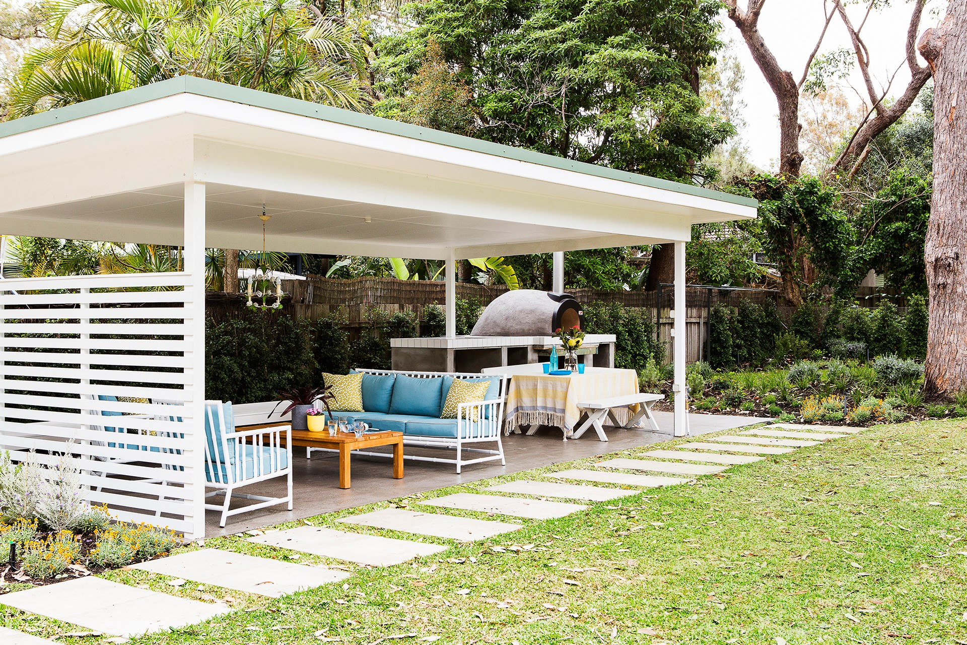 """A simple backyard pergola means the party can continue no matter what the weather's doing. Take a tour of this [beach cottage](http://www.homestolove.com.au/gallery-melissas-low-key-beach-cottage-style-2454/?utm_campaign=supplier/