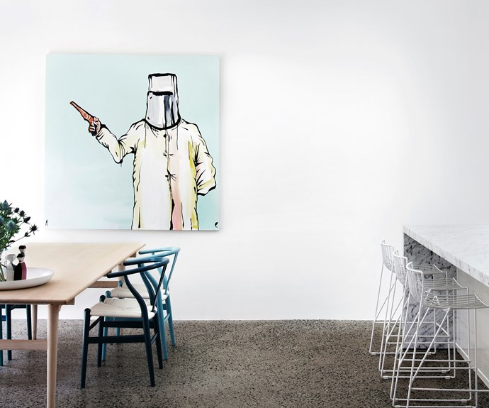 """Create your own personal gallery for guests to gaze upon. """"The owners of this Melbourne home are avid art collectors,"""" says Pip McCully, interior designer for Design Of Wonder. """"The high ceilings and polished-concrete floor in this space helped us achieve the gallery feel they were after."""" The striking Ned Kelly at Glenrowan, 2009 by Adam Cullen has a commanding presence in the room. The [Carl Hansen & Son](http://www.carlhansen.com//?utm_campaign=supplier/