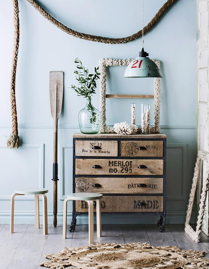 """Tie your nautical look together with lengths of marine rope and reclaimed timber features, with pastel tones for soft splashes of colour. Antique **lampshade** and Modern Vintage mangowood and iron **dresser** from [Loft Furniture](http://www.loftfurniture.com.au/