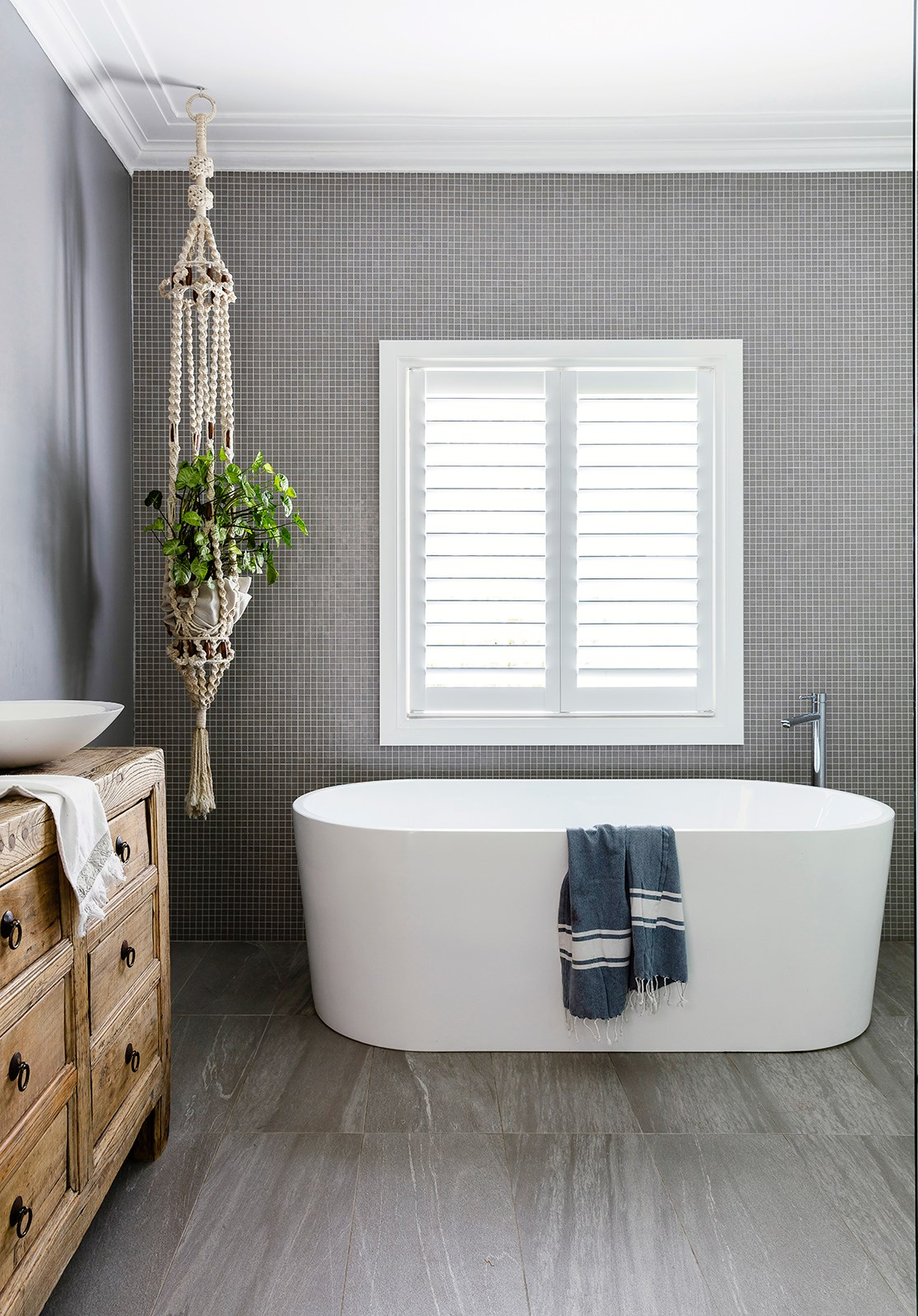 """The organic appeal of macrame and turkish towels sets off contemporary bathroom fixtures in this [serene beach house](http://www.homestolove.com.au/serene-interiors-create-beach-house-bliss-2715
