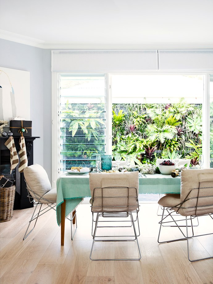"""The family was fortunate to inherit a green wall lush with thriving plants. Driade Sof Sof chairs, designed by Enzo Mari in 1971, are modern classics. **Tablecloth**, [Market Imports](http://www.marketimport.com.au/?utm_campaign=supplier/