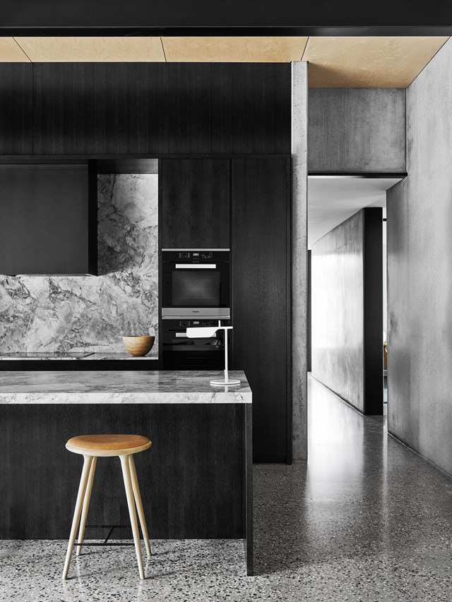 "Sophisticated yet relaxed, this kitchen has 3.6-metre-high ceilings and, although large, it is far from overpowering. Its rich, moody tones have been achieved with American oak and chunky 'White Fantasy' marble. [See more from this house here](http://www.homestolove.com.au/level-best-2642|target=""_blank""). Photo: Brooke Holm 