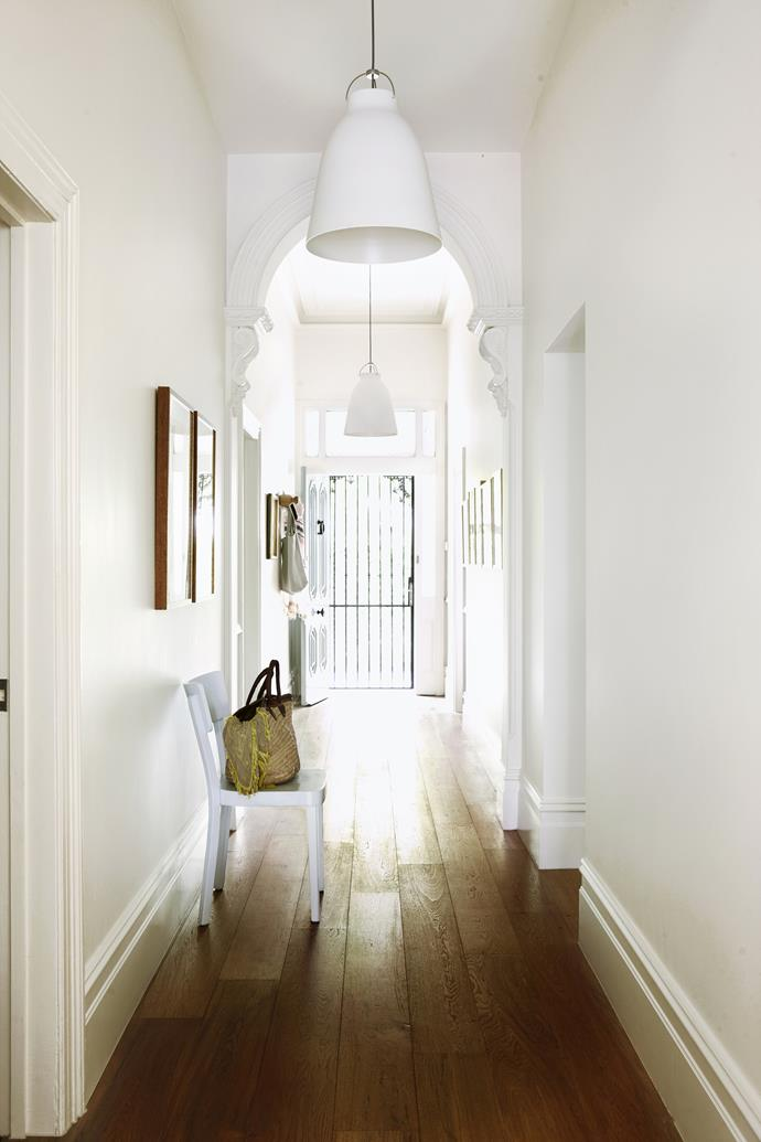 """The front door opens to a generous hallway that flows uninterrupted to the rear of the house, giving visitors tantalising glimpses of the garden and pool. Caravaggio P3 pendant **lights**from [Cult](http://www.cultdesign.com.au/?utm_campaign=supplier/