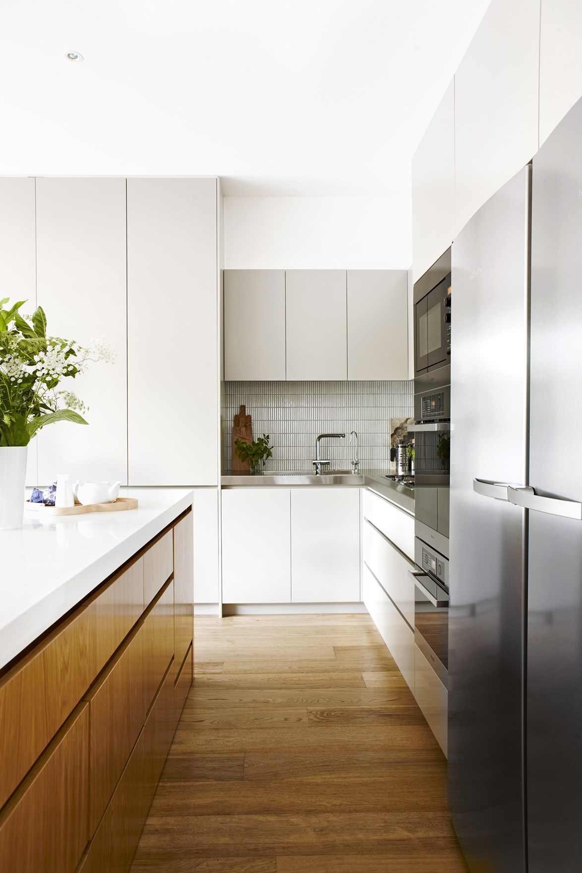 "A [Melbourne terrace house](https://www.homestolove.com.au/melbourne-terrace-house-renovation-2596|target=""_blank"") was brought into the 21st century with a sleek modern kitchen, which features handle-less flat cabinet doors in three different shades."
