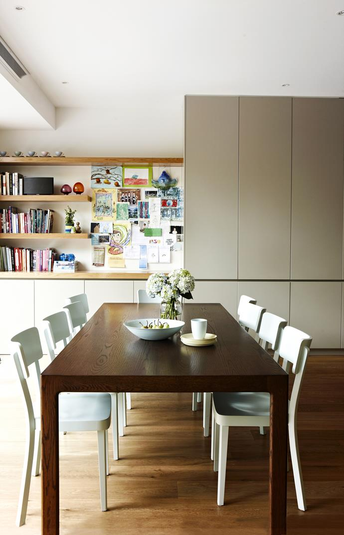 """The open plan dining area is a major improvement on what came before – there was no room for a dining table prior to the renovation – but space was limited on account of the existing pool. The 10-seater **dining table** from [Pierre and Charlotte](http://www.pierreandcharlotte.com/?utm_campaign=supplier/