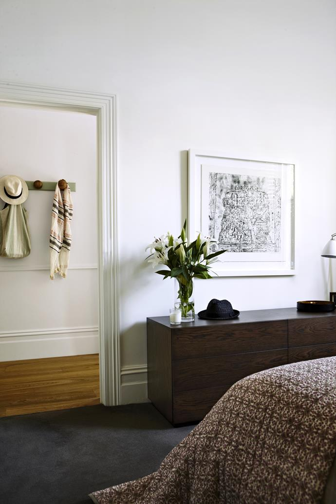 """The earthy neutral palette is soothing and works well with both the period and modern features. **Coverlet** from Altamira. **Artwork** by [Jan Senbergs](http://www.niagaragalleries.com.au/artist/jan-senbergs/?utm_campaign=supplier/