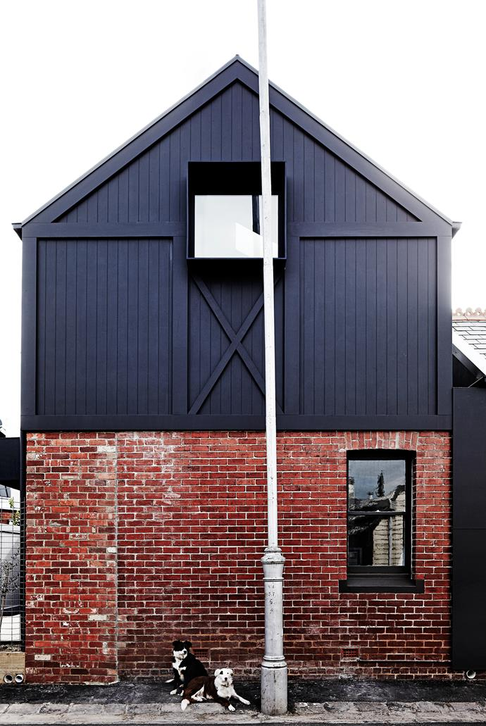 The exterior treatment of salvaged brick and blackened timber emphasises the simplicity and elegance of the form of the house.