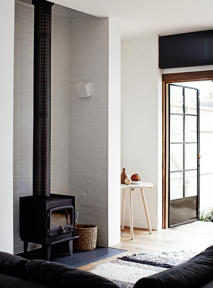 The utilitarian aspect of the house is emphasised with the honesty of a cast-iron combustion stove.