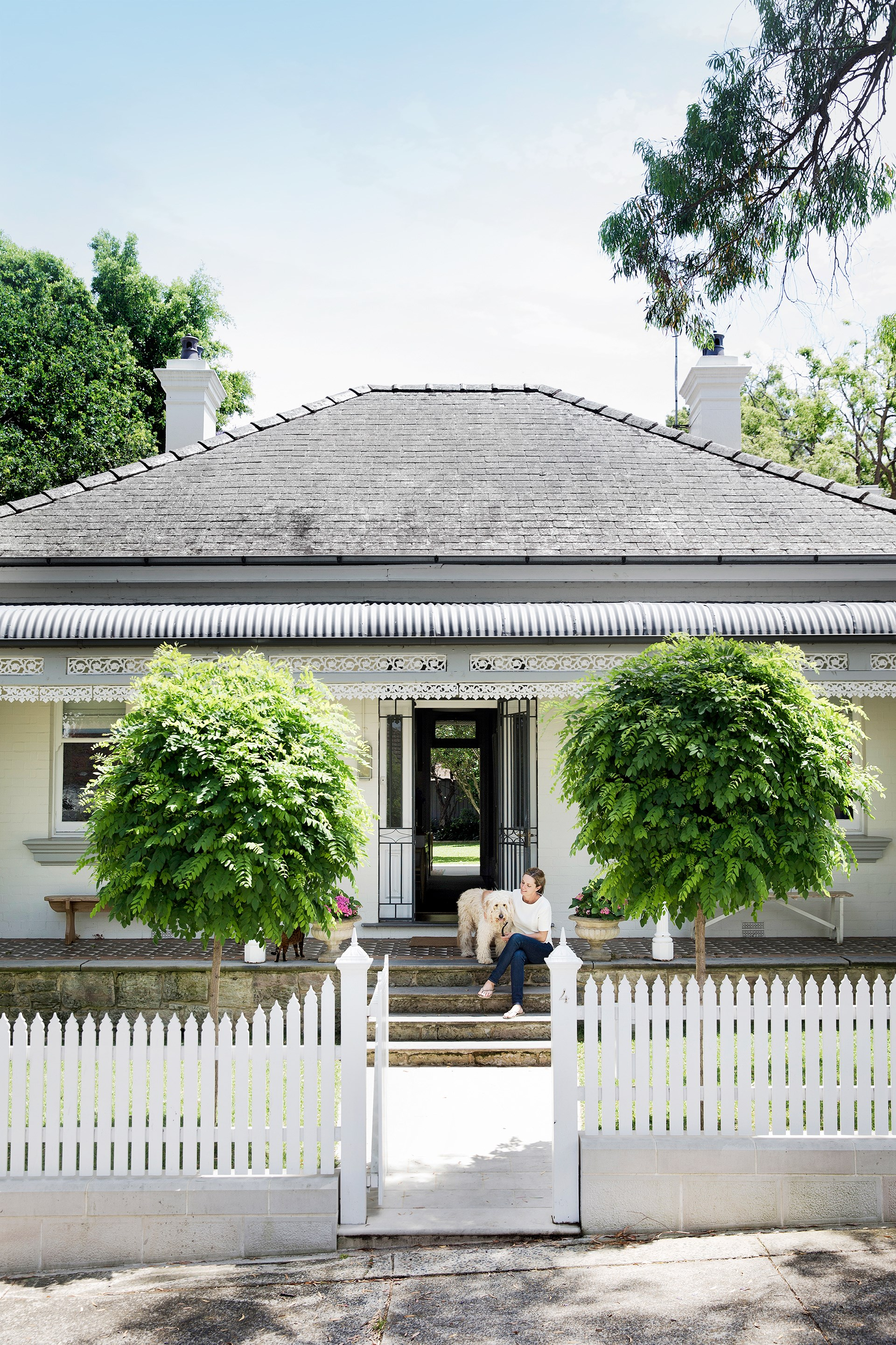 This 19th century cottage looks cute-as-pie at the front, while the back has been completely overhauled with a gargantuan shed-like extension. Take a tour of this [interior designer's own home renovation](http://www.homestolove.com.au/gallery-refreshing-extension-for-old-sydney-cottage-2755). Photo: Chris Warnes / *Australian House & Garden*