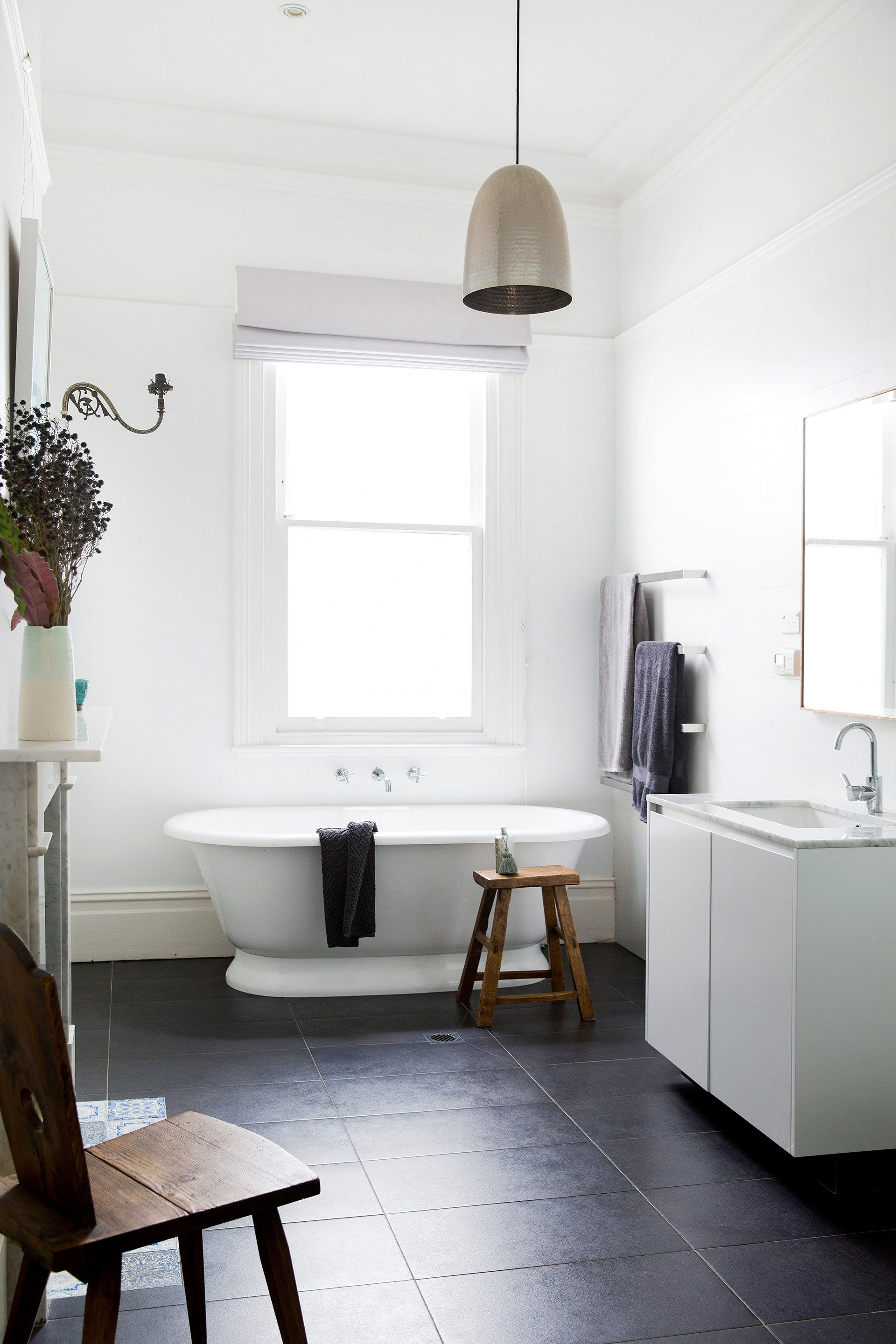 """This old-world bathroom was once a bedroom in this [original 19th century cottage](http://www.homestolove.com.au/gallery-refreshing-extension-for-old-sydney-cottage-2755