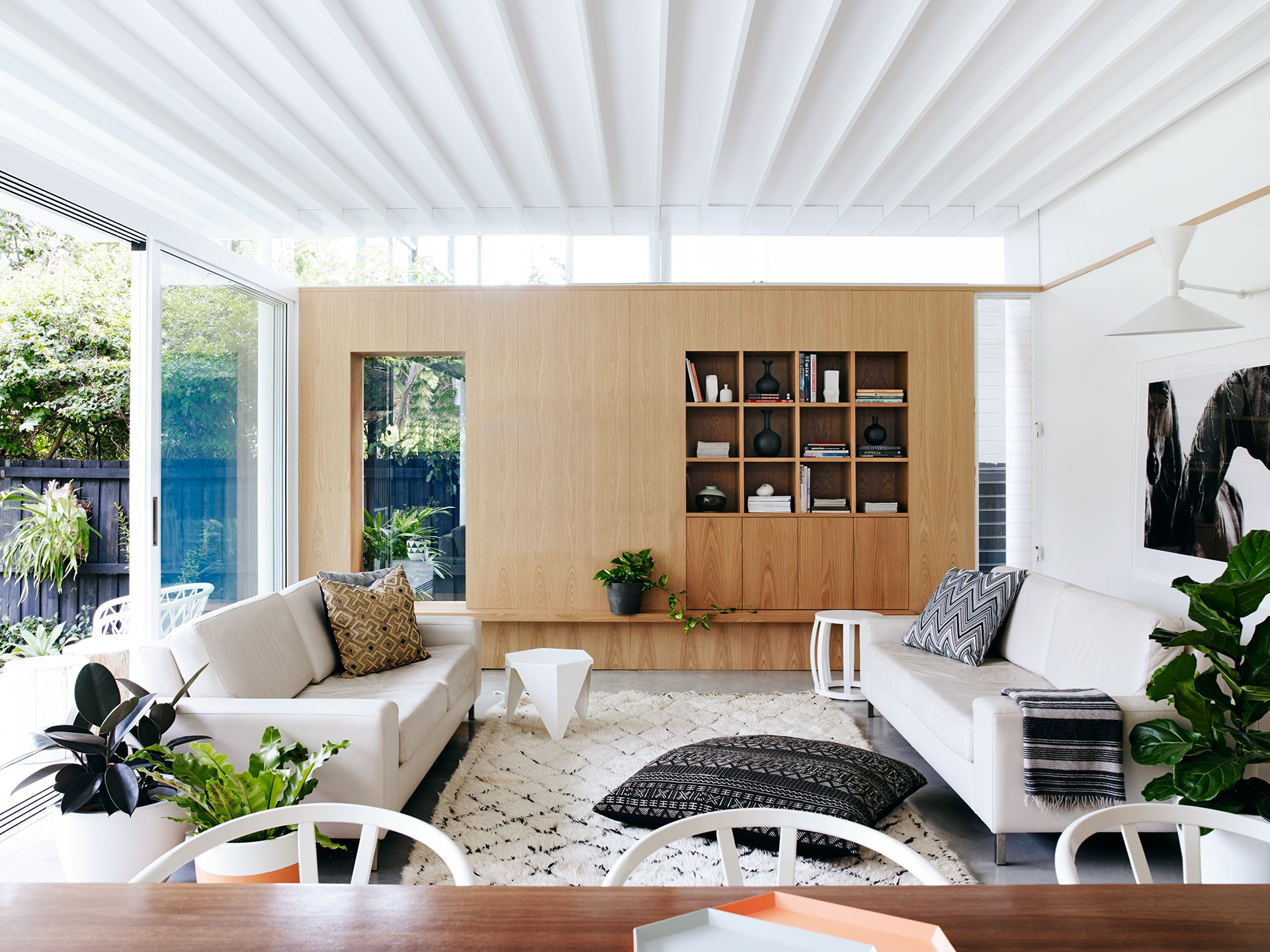 """See more of this [dazzling duplex overhaul](http://www.homestolove.com.au/modernism-inspires-laid-back-family-home-2762