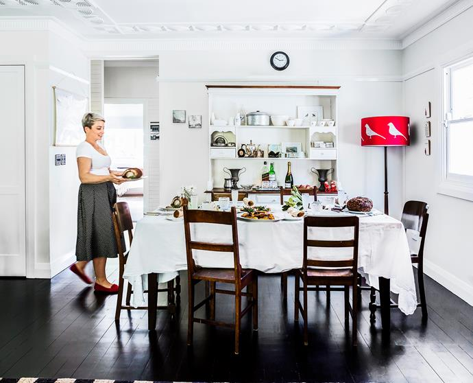 A vintage tablecloth and chairs sets the scene for the Christmas feast. On the menu this year are Jamie Oliver's porchetta and Yotam Ottolenghi's roasted potatoes with caramel and prunes. Photo: Maree Homer | Styling: Janet James