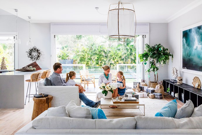 """Russell and Romy get into the spirit of Christmas giving with daughters Anais (left) and Milla. **Sofa** from [Jardan](http://www.jardan.com.au/?utm_campaign=supplier/
