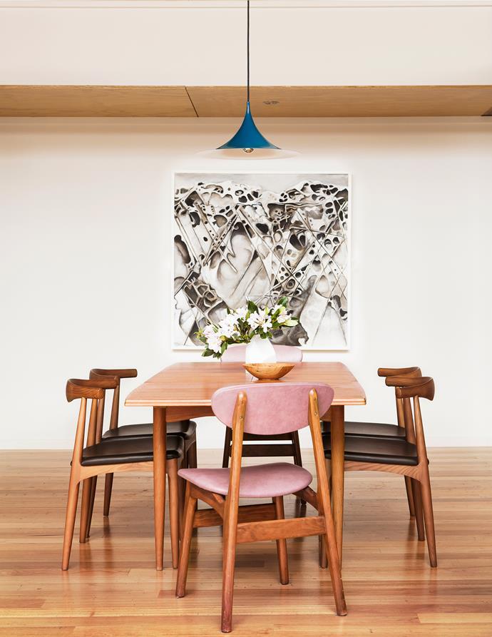 "A vintage Parker table in teak takes pride of place in the dining room. Replica Hans Wegner Elbow **chairs** from Bonderup & Thorup](http://www.gubi.dk/en/designers/bonderup-thorup//?utm_campaign=supplier/ target=""_blank""). Pendant light sourced in Denmark. Artwork by Francis Luke."