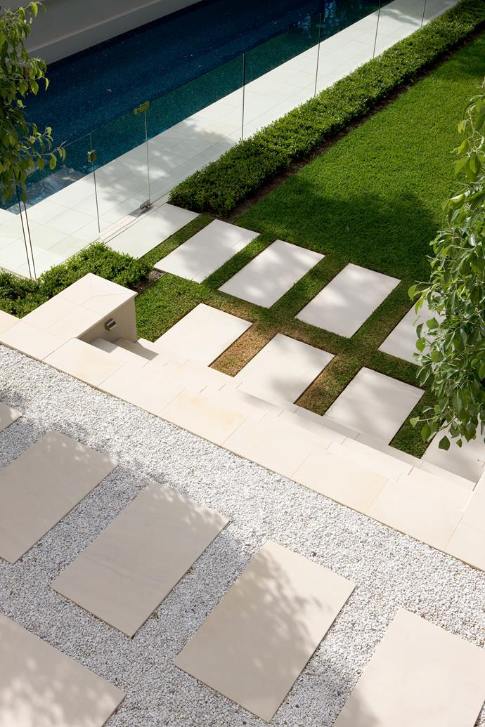 Large stone steppers connect the stairs to the pool and lend a strong contemporary feel to the rear garden.