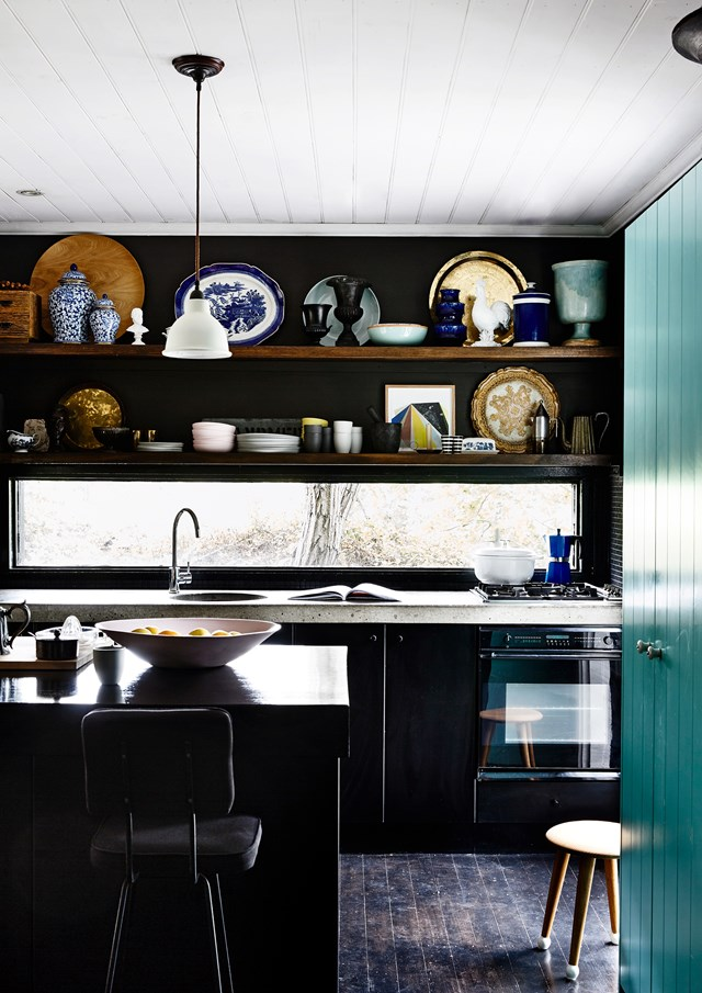 "Black cupboards and a concrete benchtop bring urban chic to any kitchen, as seen in the part-time home of artist, interior designer and art educator Simon Carver. [See more from this home here](http://www.homestolove.com.au/city-style-in-a-country-cottage-2622|target=""_blank""). Photo: Derek Swalwell 