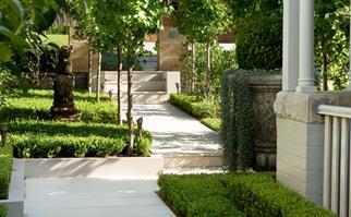 Formal sandstone paved garden entrance
