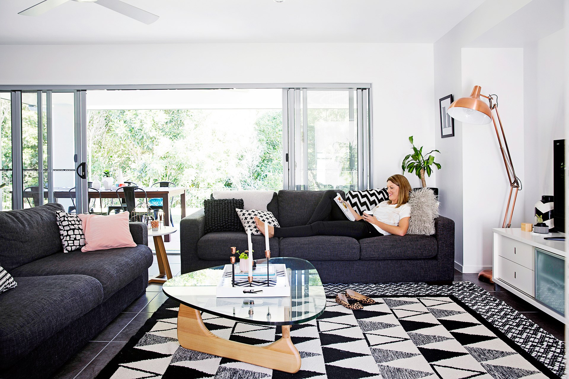 A bold black and white rug packs plenty of punch in the living room of this [graphic family home](http://www.homestolove.com.au/diy-family-builds-their-ideal-home-2801). Photo: James Henry / *homes+*