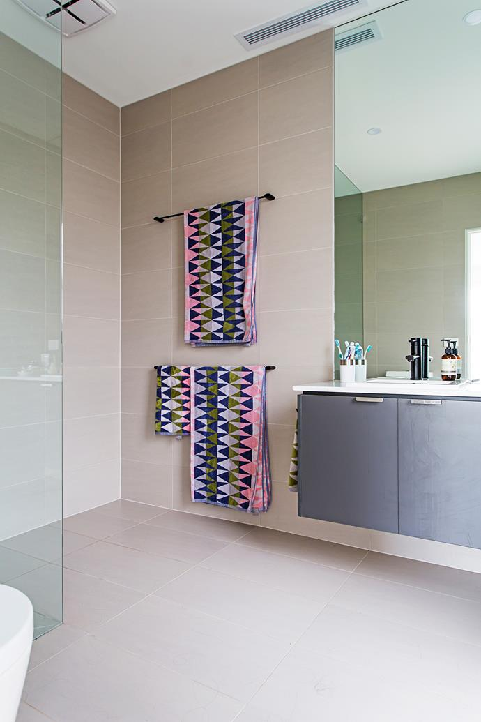 Neutral tiles guarantee longevity in the bathroom.