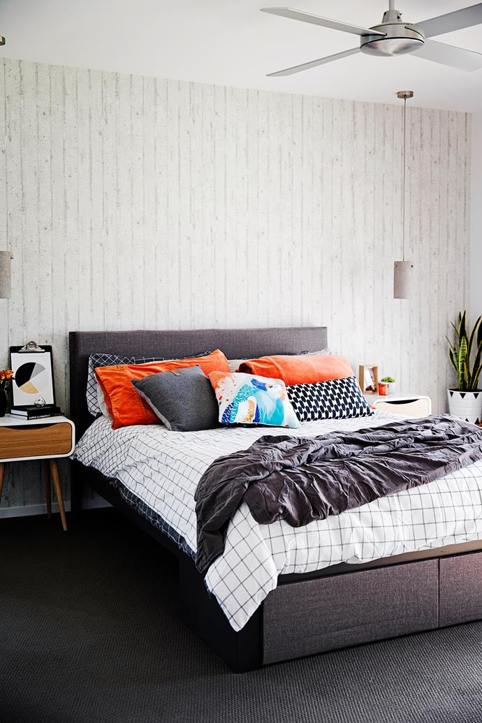 """This room is always a work in progress, with bedspread and cushion changes,"" Julie says. The bed has been spray-painted grey and the headboard reupholstered in a charcoal linen."
