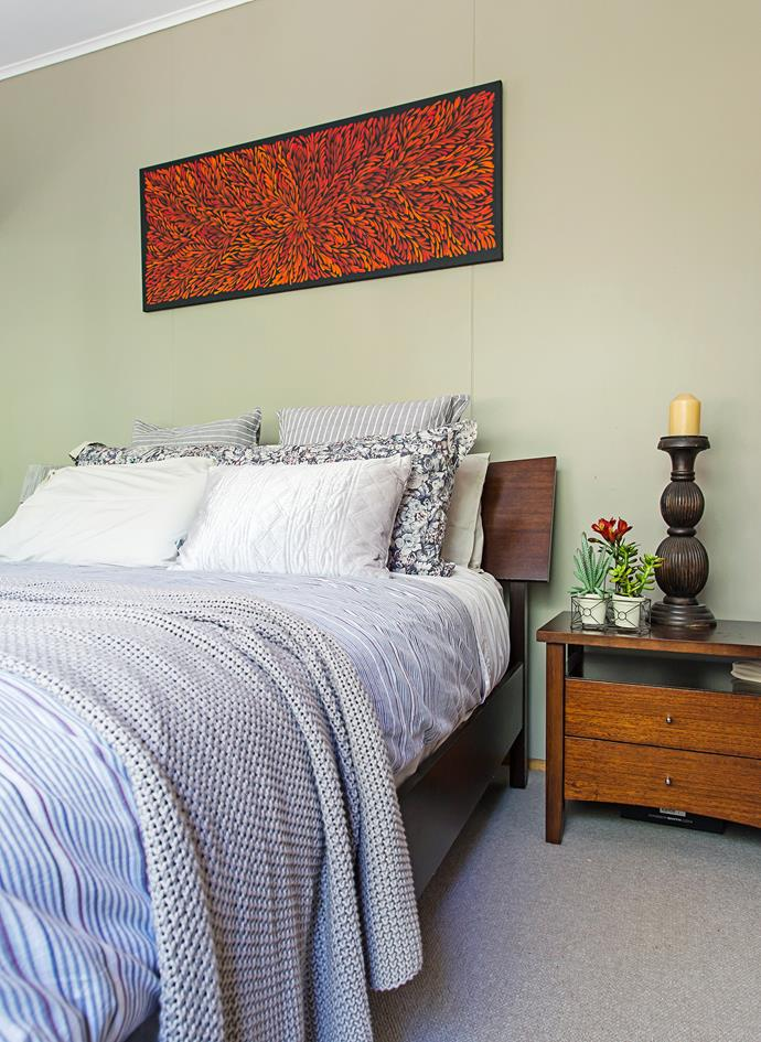 """""""I love to buy good-quality linen and throws for the beds when they are on sale,"""" says Judy. """"Our daughter bought the art above our bed on a trip to Central Australia – we love it!"""""""