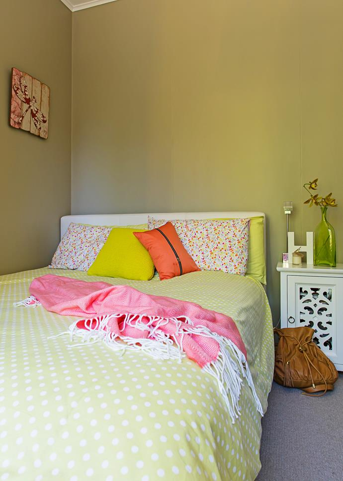 White furniture allows colour accents to pop in Harriet's room.