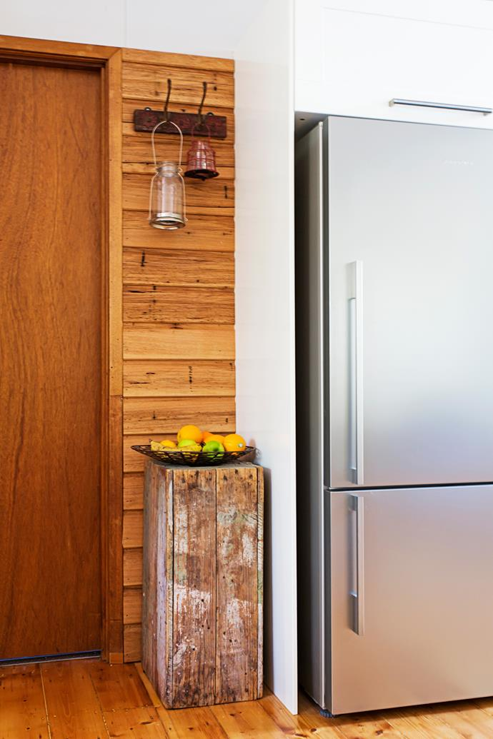 A simple recycled wood block adds a rustic touch to the kitchen.