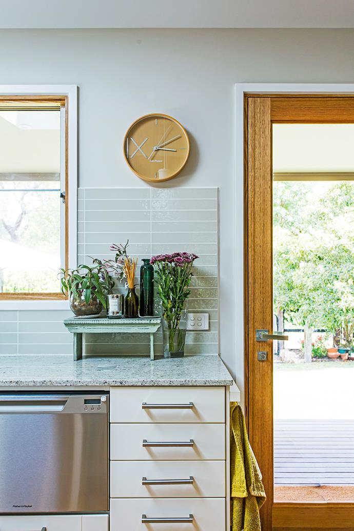 """""""We chose high-gloss glass tiles for the splashback – we love the neutral colour,"""" Judy says."""