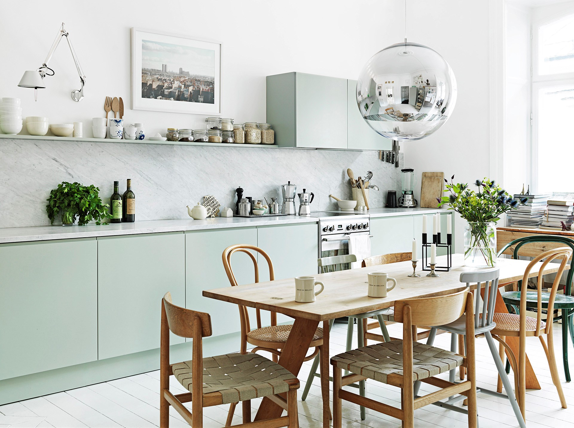 "A metallic sphere really ups the tempo in this soothing scandi-style kitchen. Take a look around this [crisp white family apartment](http://www.homestolove.com.au/family-living-in-a-crisp-white-apartment-2519|target=""_blank""). Photo: Petra Bindel @ House of Pictures / *real living*"