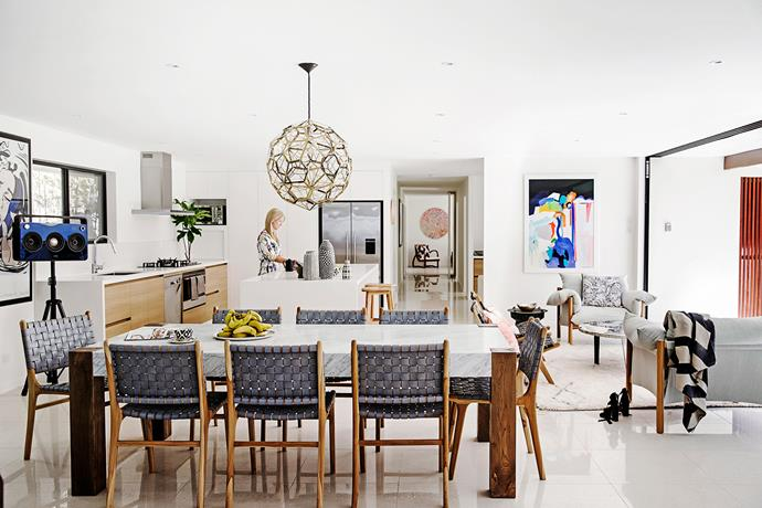 """Kelli wanted to use the elements of stone and wood in the interior, reflecting the surrounding environment. """"Being at the beach and having two young boys, it was important for us that the house be easy and functional for our lifestyle,"""" she says. The marble-topped dining table is from [Coco Republic](http://www.cocorepublic.com.au//?utm_campaign=supplier/