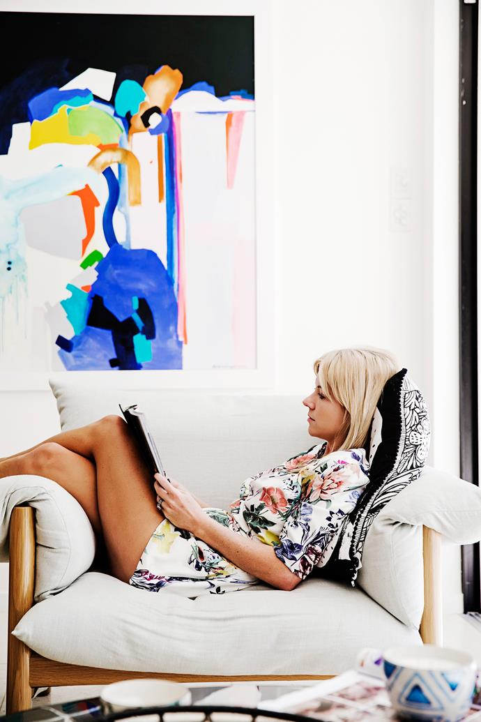 The Wilfred armchair from Jardan is made for kicking back in and enjoying a good mag. The artwork is by Ali McNabney-Stevens.