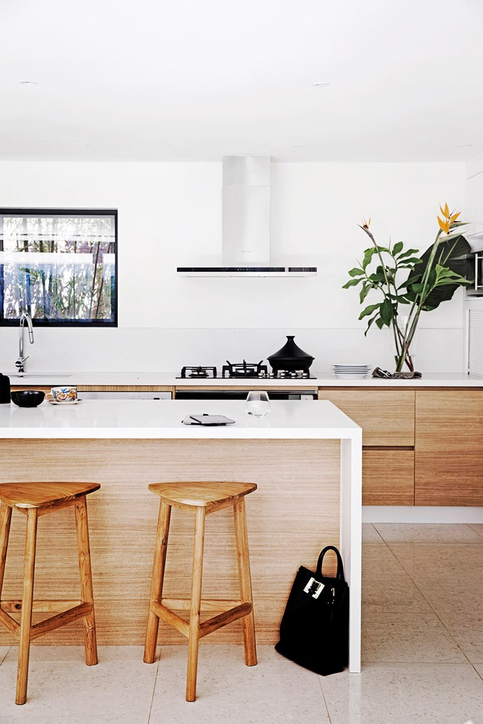 """The timber finishes of the kitchen cabinetry and island bench gives [this Byron home](http://www.homestolove.com.au/blonde-brick-byron-home-gets-a-beachy-revamp-2839