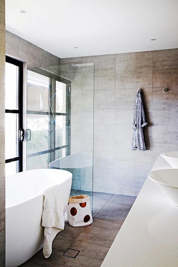 The bathroom features Bianco Industry Silver tiles from Byron Bay Tiles.