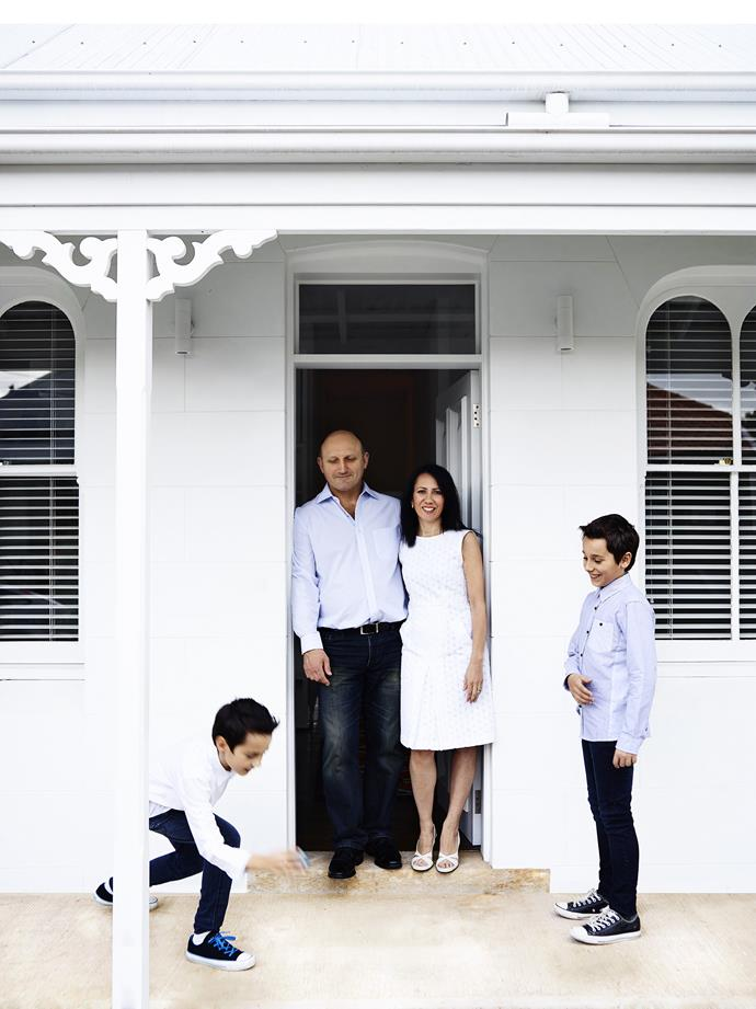 Owners Eddie and Sarina Gonano, pictured with sons William (left) and Jonathan, at the door of their home, which was originally a pair of worker's cottages.