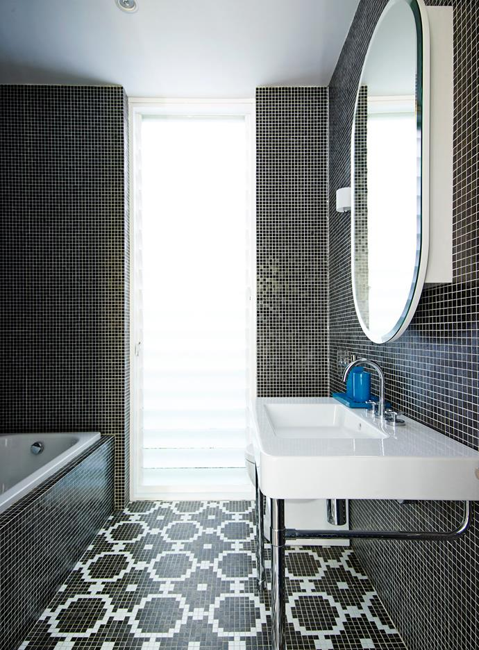 "Mosaics and custom joinery create a monochrome masterpiece in the downstairs bathroom. **Mosaic tiles** from [Trend](http://www.trendwindows.com.au/?utm_campaign=supplier/|target=""_blank""). **Basin** and **chrome stand** from [Rogerseller](http://www.rogerseller.com.au/?utm_campaign=supplier/