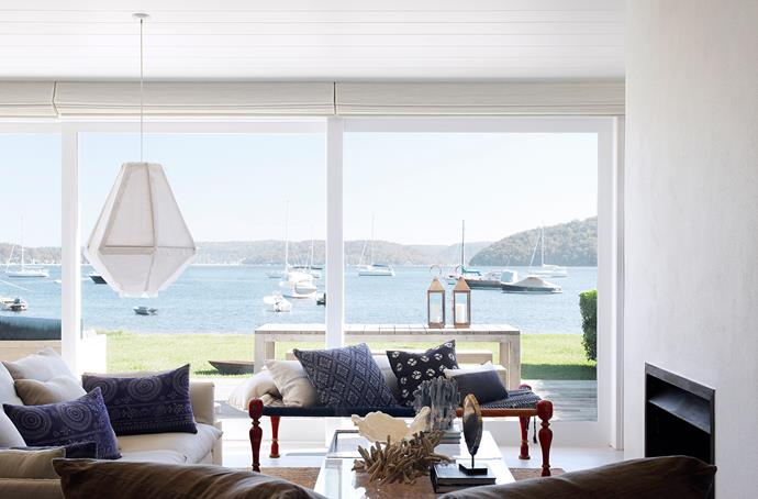 "The open-plan living room spills out to a level waterfront lawn, with stunning views over Pittwater.  ""My goal was to create a comfortable family beach shack for entertaining, but with a sophisticated twist,"" says the owner. **Sofa** from [Jardan](http://www.jardan.com.au/