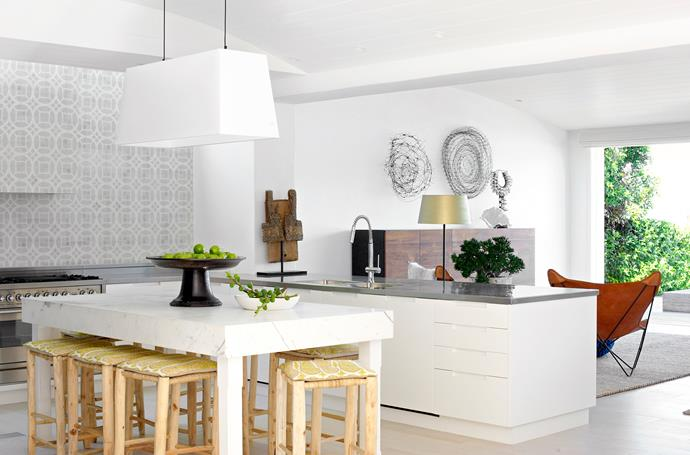 "Moroccan stools in the kitchen surround a Calacatta marble bench that was designed by Justine. Moooi **light** from [Space](http://www.spacefurniture.com.au/|target=""_blank""). Cushion **fabric** from [Tigger Hall Design](http://www.tiggerhall.com.au/