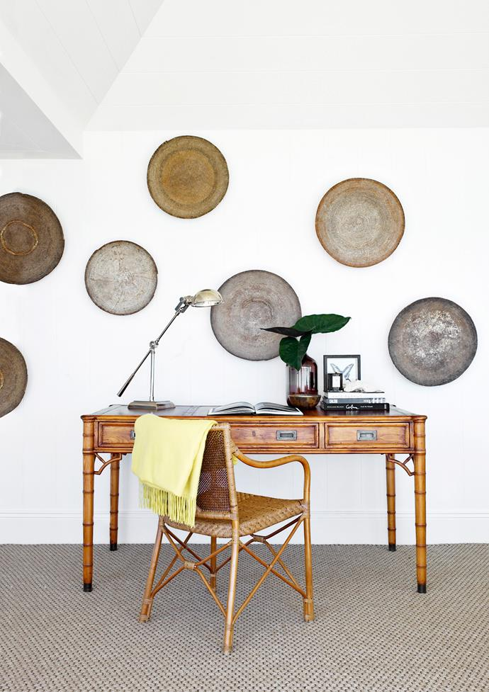 "African baskets from [Les Interieurs](http://www.lesinterieurs.com.au/|target=""_blank"") adorn the walls of the study nook in the main bedroom. Bamboo **desk** from [The Country Trader](http://www.thecountrytrader.com.au/