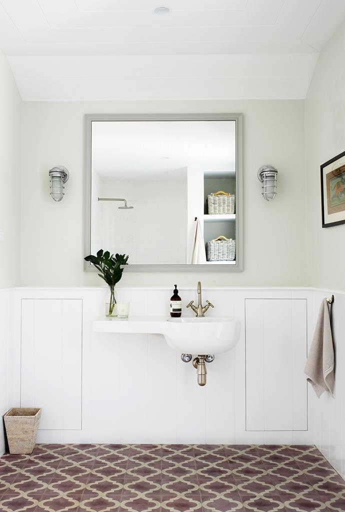 """The powder room has a Pozzi Ginori basin from [Reece](http://www.reece.com.au/ target=""""_blank""""), and marine lights sourced from the US."""