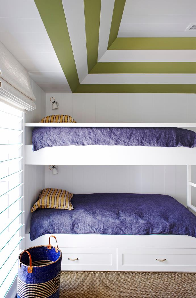 "The tongue-and-groove ceiling in the bunk room is painted in graphic stripes. **Bed linen** by [Libeco](http://www.libeco.com/|target=""_blank""). Sibella Court **handles** from [Anthropologie](http://www.anthropologie.com/