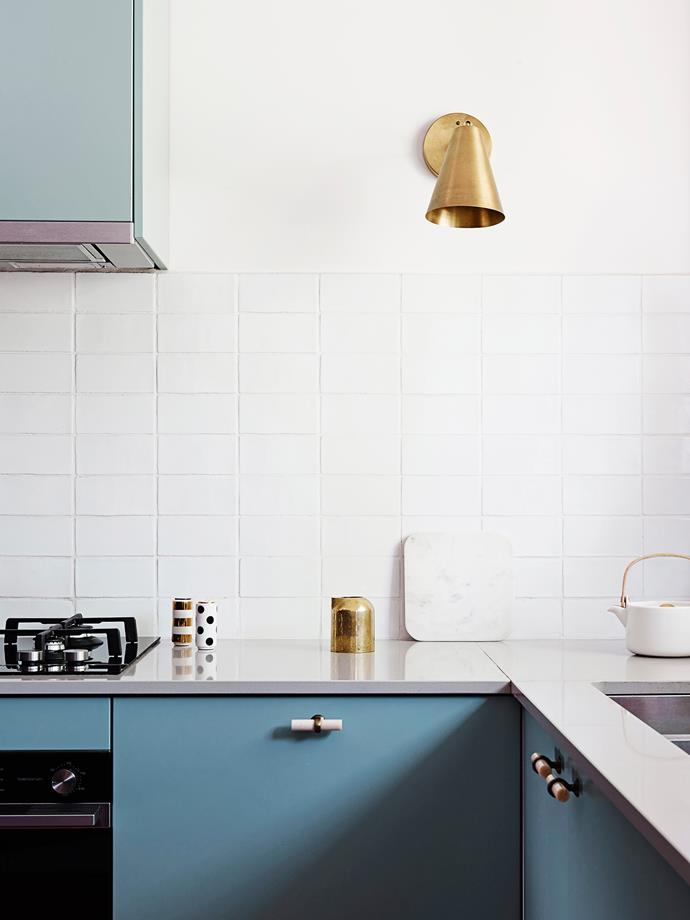 """It's the attention to detail that gives this home panache. The brass wall light in the kitchen, from [Cedar & Moss](http://www.cedarandmoss.com//?utm_campaign=supplier/