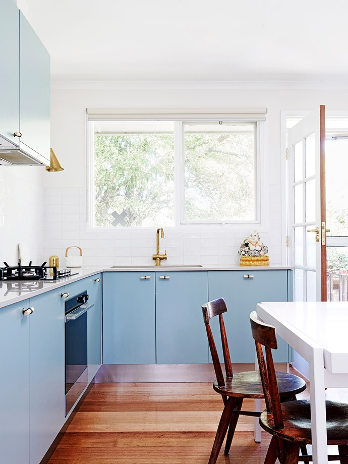 """The copper and powder blue finishes of this creative kitchen work wonderfully with the subway tiles. And the best part? The  Ikea cabinetry allows for easy and inexpensive changes to the doors should the owner decide to renovate again in the future. Take a tour of [this light-filled home](http://www.homestolove.com.au/interior-designer-lauren-lis-creative-home-renovation-2843