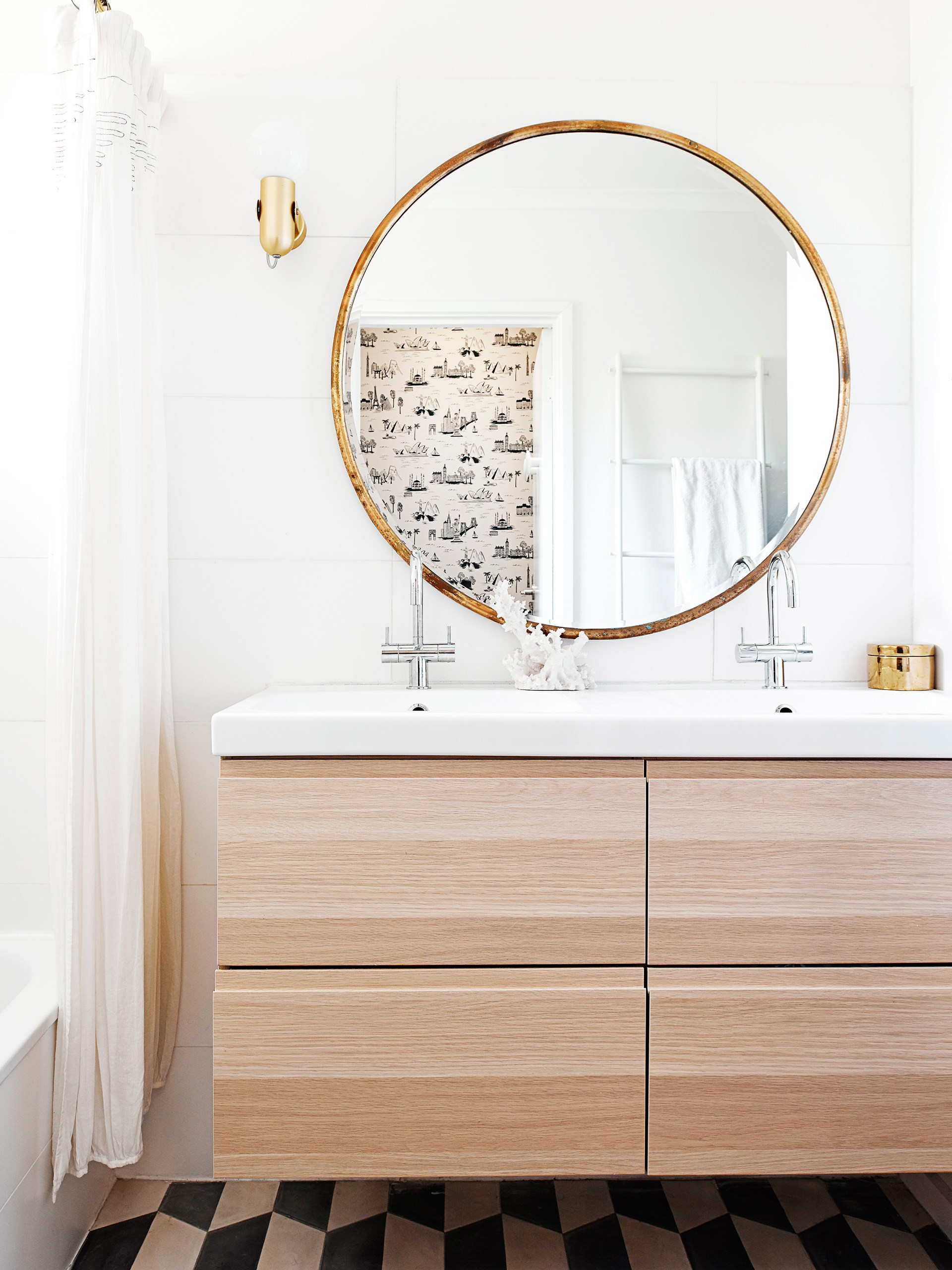 "Brass wall sconces add a luxe touch in the bathroom of this [Scani-retro unit](http://www.homestolove.com.au/interior-designer-lauren-lis-creative-home-renovation-2843|target=""_blank""). Photo: Eve Wilson / real living"