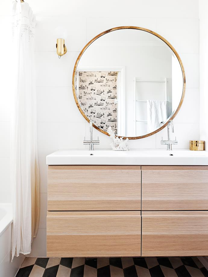 """Lauren removed a cupboard to extend her renovated bathroom, above left, and include a laundry. """"Having a double vanity was non-negotiable!"""" she says. """"Although the bathroom is small, we managed to fit it in and it works well for our family."""""""