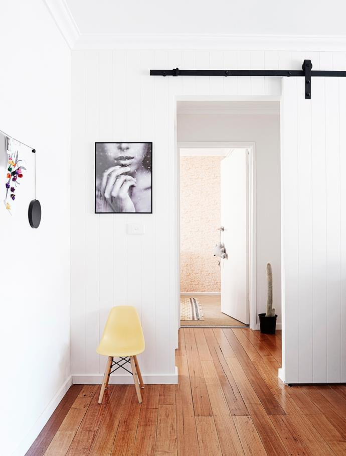 In the living room, a '70s archway was replaced with a barn-like, steel sliding door, from eBay, to minimise noise.