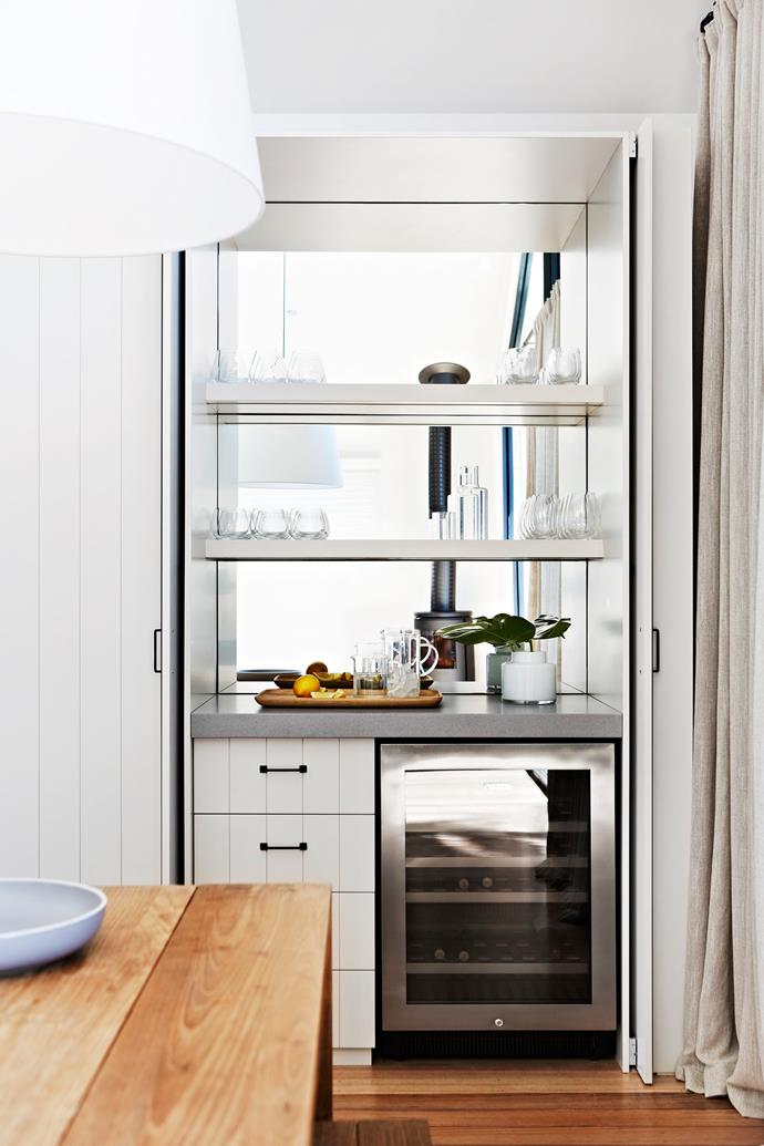 "A cocktail bar, complete with wine fridge, is built into a nook between the kitchen and dining area for easy access when entertaining. Vintec **wine fridge**, [E&S Trading](http://www.estrading.com.au//?utm_campaign=supplier/|target=""_blank"")."