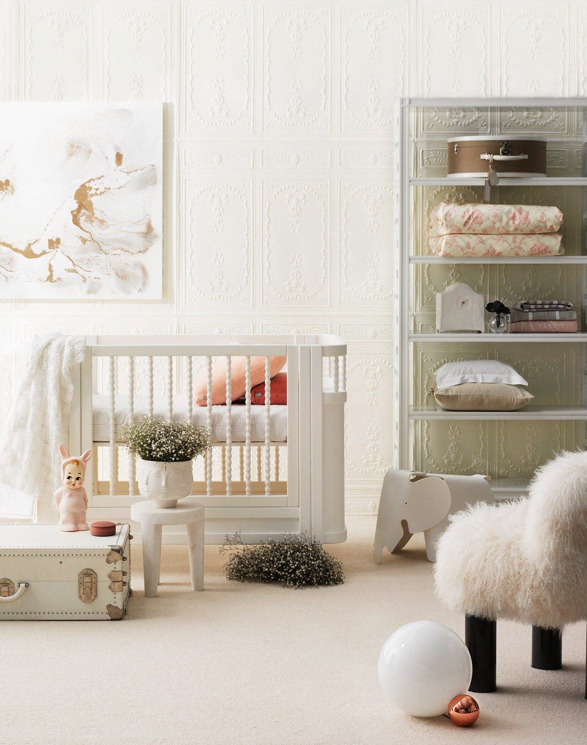 """Adorned with designer furniture items such as a Prada trunk from [Vintage Luggage Company](https://vintageluggage.com.au/ target=""""_blank"""" rel=""""nofollow"""") and a luxurious textiles like a handmade shawl and quilt from [Adrienne & the Misses Bonney](http://www.missesbonneystives.com.au/en/ target=""""_blank"""" rel=""""nofollow""""), this high-end nursery has 'royal' written all over it. *Photo: Edward Urrutia   Styling: Megan Morton, Steve Cordony*"""