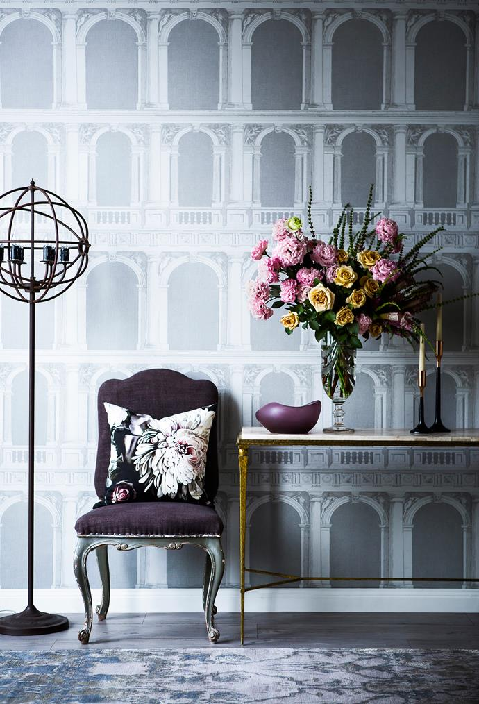 A statement floral cushion and beautiful bouquet embrace the modern floral trend without going OTT. Place leggy furniture and shapely objects against a repeating pattern to please the eye. Dark Floral II Black Saturated cotton and linen **cushion cover**, Ellie Cashman Design.