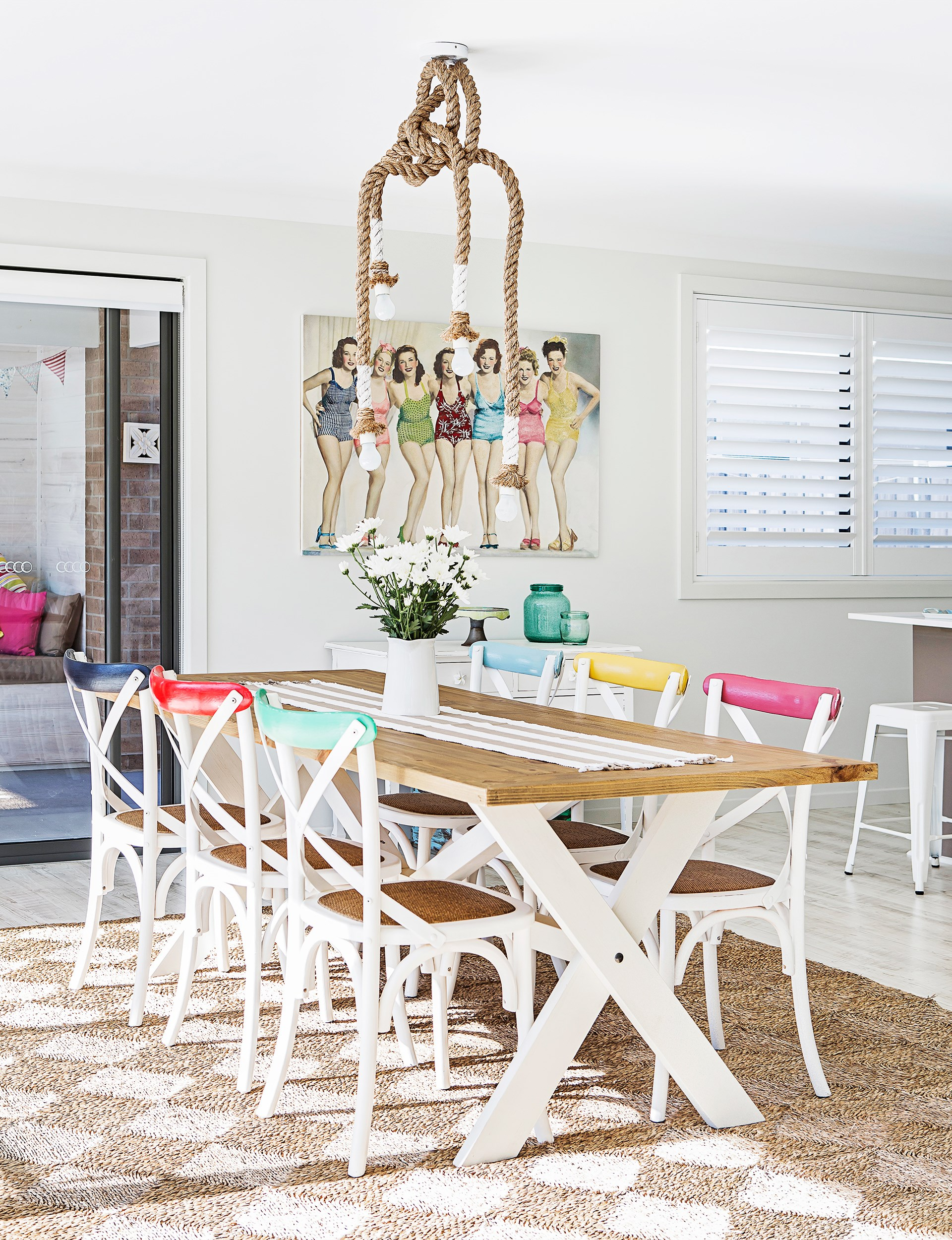 "A rope pendant light from [Freedom](http://www.freedom.com.au/?utm_campaign=supplier/|target=""_blank"") adds to the beachy vibes of this fresh, fun dining area. Take the tour of this [coastal-style overhaul of a single storey home](http://www.homestolove.com.au/empty-nesters-embrace-coastal-style-2918
